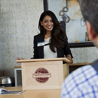 Woman giving a presentation behind a lectern