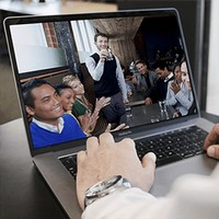 A laptop screen showing a meeting in progress